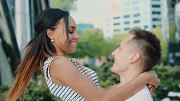 Happy young man spinning around his mixed-race girlfriend in a beautiful place Live Action