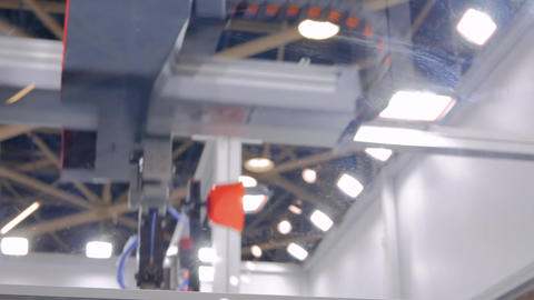 Automatic robotic arm manipulator with suction cups moves plastic pots at fabric Footage