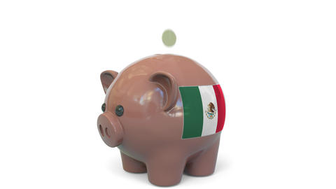 Putting money into piggy bank with flag of Mexico. Tax system system or savings Live Action