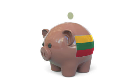 Putting money into piggy bank with flag of Lithuania. Tax system system or Live Action