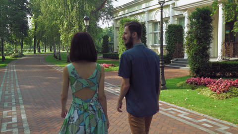 Young couple near the track is in a beautiful old park Footage