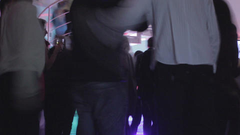 Silhouette of many people grooving, moving in night club Footage