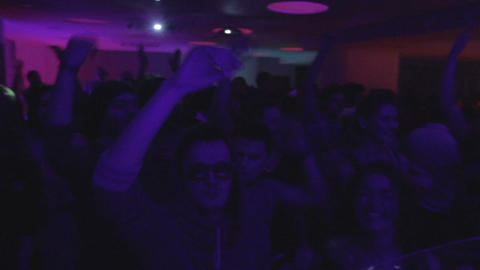 Many people dancing in the night club. Hands in the air, emotions and drive Live Action