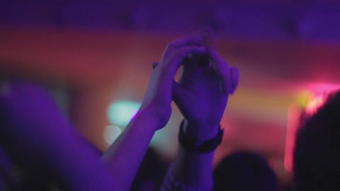 Hands clapping close-up. People dancing in nightclub Footage