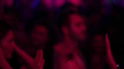 Teen girl enjoying music on a dance floor waving hand in the nightclub air Live Action