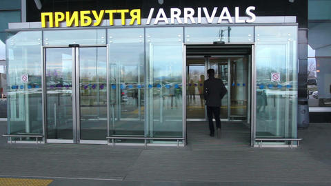 Airport arrival Arrivals sign with automatic doors Live Action