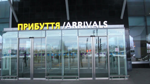 Airport arrival Arrivals sign with opening automatic doors Live Action