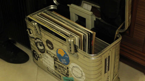 DJ case with lots of records in it Live Action