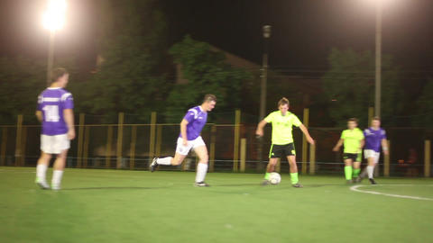 Soccer player giving pass. Forward strikes on goal Footage
