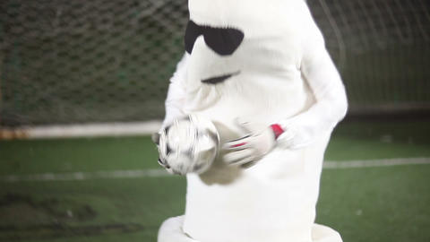 Funny man in condom costume acting as a football goalkeeper Footage