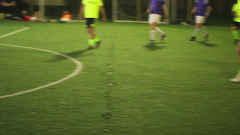 Forward attacks and strikes on goal in a football match. Youth training Footage