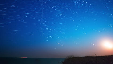 Stars and Moon over the Sea. Time Lapse 4K Footage