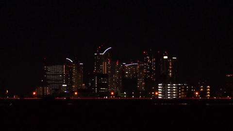 Scenery which runs the high-rise buildings and the car (night view, Pan) Footage
