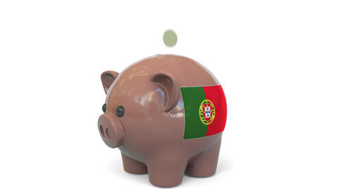 Putting money into piggy bank with flag of Portugal. Tax system system or Live Action