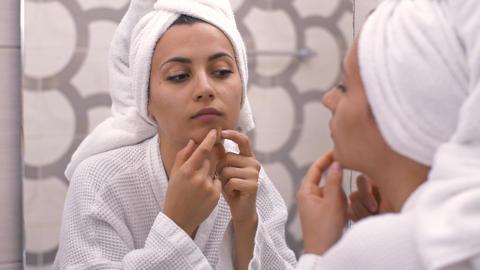 Woman squeezing pimples Live Action