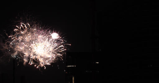 Fireworks near the building at the urban city in Tokyo at summer night long shot ビデオ
