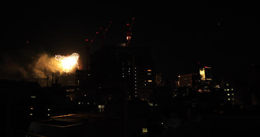Fireworks near the building at the urban city in Tokyo at summer night wide shot Footage