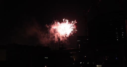 Fireworks near the building at the urban city in Tokyo at summer night wide shot Live Action
