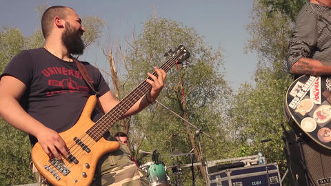 Bassist of a rock band he plays his instrument live Live Action