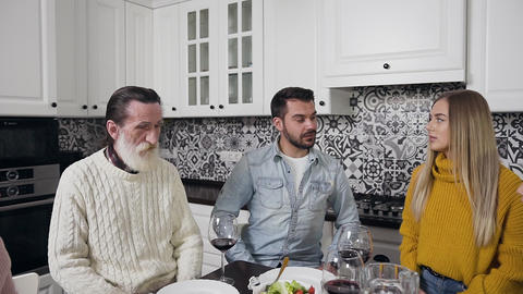 Pleasant cheerful family with old bearded grandpa sitting around the festive Footage