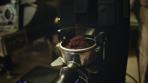 Coffee grind drops to a horn GIF