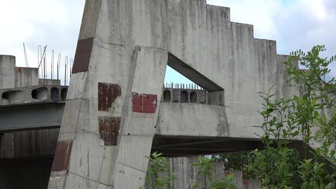 Derelict unbuilt stadium construction ruins in city Live Action