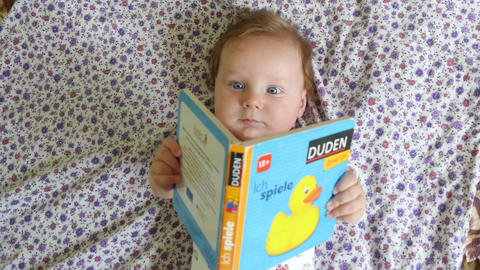 Baby Playing With Story Book Live Action
