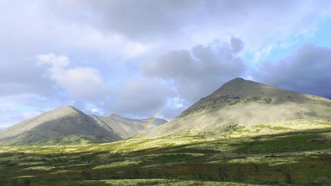 Cloud and Rainbow Over Mountain Footage