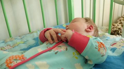 Baby Boy Liesin In The Crib Footage
