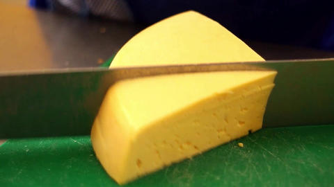 Sliced hard cheese with small holes Footage
