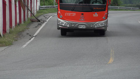 Red Tour Bus on Curve Live Action