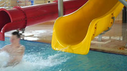 Teen Enjoying Ride On Water Slide Footage
