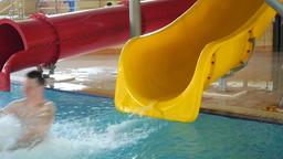 Teen Enjoying Ride On Water Slide Footage