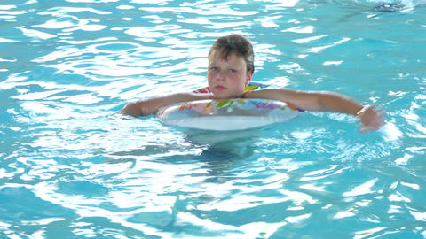Boy Swimming With Inflatable Ring Footage