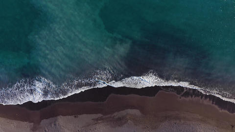 Top view of the desert black beach on the Atlantic Ocean. Coast of the island of Archivo