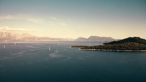 Aerial view of picturesque mountainous islands and sailing yachts in the Ionian Footage