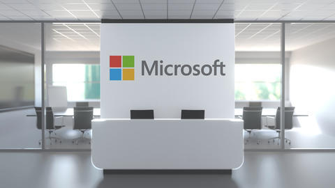 MICROSOFT logo above reception desk in the modern office, editorial conceptual Live Action