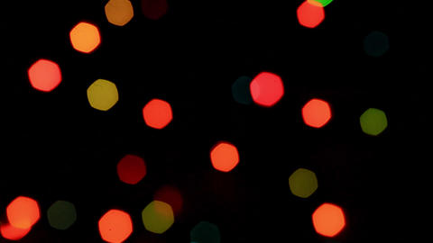 Colored flickering bokeh on a defocused garland Live Action