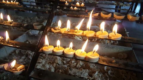 Burning candles is church on plateau in church Live Action