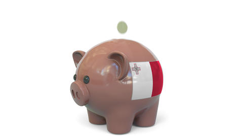 Putting money into piggy bank with flag of Malta. Tax system system or savings Live Action