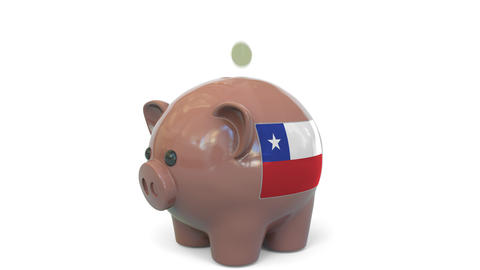 Putting money into piggy bank with flag of Chile. Tax system system or savings Live Action