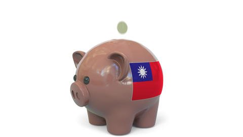 Putting money into piggy bank with flag of Taiwan. Tax system system or savings Live Action