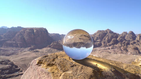 crystal ball on beautiful background of wonderful mountain landscape, petra Live Action