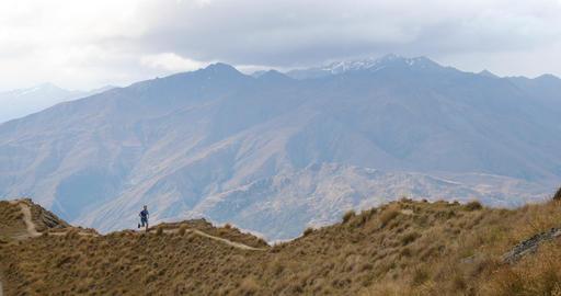 Running man atlete on trail run in mountains Footage