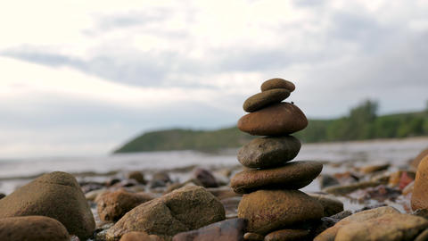 Stack of the rock and sea wave coast to beach with stone sand and rock Live Action