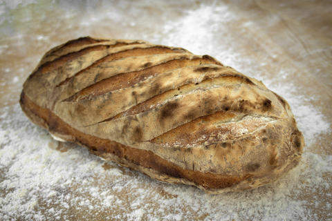 Handmade bread of different types of flour baked in a wood oven Photo