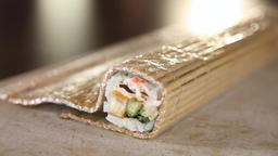 Sushi making process. Rolls the sushi roll on bamboo mat. Stacking of Footage