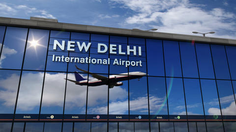 Airplane landing at New Delhi mirrored in terminal Live Action