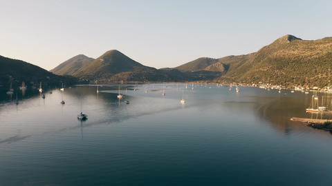 Low altitude aerial view of sailing boats near coastal town of Nydri. Lefkada Footage