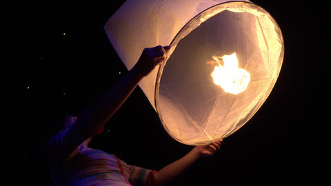 Asian Woman Releases A Sky Lantern GIF